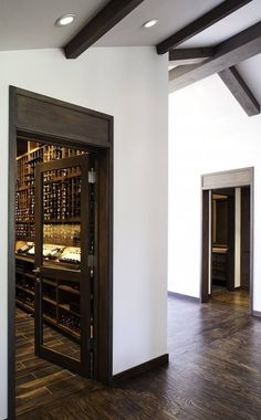 Wine cellar with glass door. Love the white and dark wood contrast. A more modern entrance? Wine Storage, Tall Cabinet Storage, Storage Ideas, Caves, Wine In The Woods, Home Wine Cellars, Modern Entrance, Modern Door, Wine Display