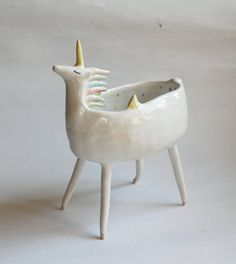 Unicorn bowl with pastel polka dot. He was made completely by hand. All of his attributes was also painted by hand. Materials: white clay, white