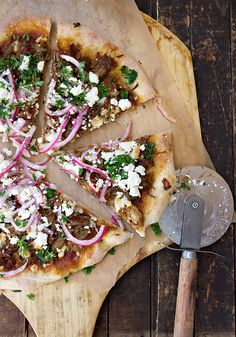 Carnitas Pizza loaded with slow-cooked Mexican pulled pork