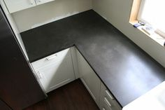 Black concrete countertop.  Looks like soapstone, but less expensive and perhaps hardier?