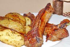 Retete Culinare - Coaste de porc dulci-picante cu garnitura de cartofi noi