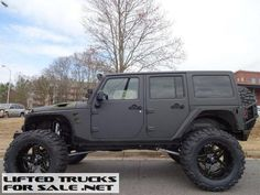 NOTE: Green accents. 2015 Jeep Wrangler Unlimited Rubicon Custom Kevlar Coated Lifted