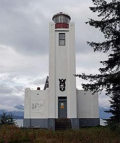 """Sentinel Island Lighthouse Juneau, AK """"Rustic and remote"""" would be the words for an overnight stay at the Sentinel Island Lighthouse, where your way in and out is by sea kayak, charter boat, or helicopter, and your bed is a simple bunk in the Art Deco lighthouse or a sleeping bag in a tent pitched outside. But the payoff is huge: the run of the six-acre island in Alaska's Inside Passage on which the 1935 lighthouse is set, and a glorious vantage point for spotting whales, eagles, and sea lions."""