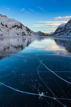 Cracks on Lago di Fedaia. Photographer Hrvoje