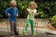 stilts! idea - wood chunks ~easier than gathering enough equal sized cans. Visit www.yourtherapyso... for more sensory motor activities.