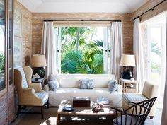 Technically not wallpaper but bug-resistant pecky cypress rubbed with lime to create the look of driftwood.  Harbour Island Bahamian home by designer Tom Scheerer