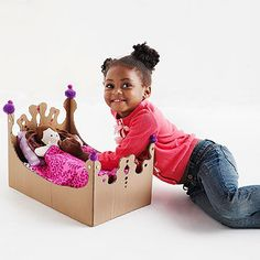 A crafted cardboard bed will give your child's fave doll some serious slumber. Plus, it's so E-Zzz to make.                 What you'll need: 17x11x11-inch box, scissors, paper, tape, pencil, crafts knife, cutting mat, hot-glue gun, pom-poms, large sequins                 Make it: While box is flat, cut off the four top flaps. Fold a piece of paper in half so it measures 8 1/2x5 1/2 inches. Hold folded paper vertically and cut a decorative design across the top portion. Unfold, tape to one…