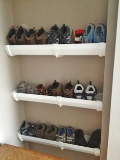 This shoe rack barely takes up any space and will keep the clutter off the floor.