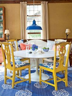 There's nothing wrong with classic color combinations, but an unlikely addition -- such as the orangey-coral in this dining area in Sag Harbor, New York -- amps up this palette. Cover walls with burlap to get warmth and texture for a lower price than grass cloth. (Photo: Peter Murdock)