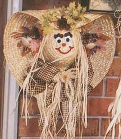Straw hat decorated with a happy scarecrow face for Fall.