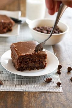 The World's Best Chocolate Oatmeal Cake, recipe from Mimi's Grandma --  Lightly chocolatey, super moist, studded with chocolate chips, and topped with an old fashioned chocolate marshmallow f...