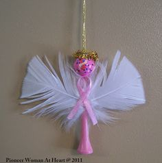 pink ribbon ornaments handmade | Pink ribbon angels made from golf tees, feathers, ribbon, and beads ...