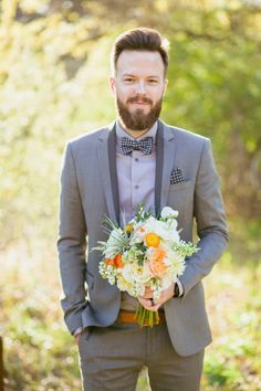 Love this groom's sleek gray suit and dotted tie!