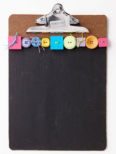 Use chalkboard paint to convert a clipboard into a message board and finish off with some pretty buttons.    #buttons, #chalkboard