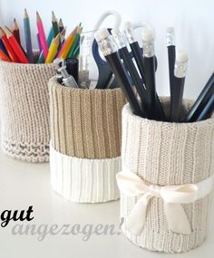 Re-use cans and old sweaters could also glue on to box and make fabric boxes