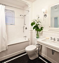 Subway tile in bathroom. http://www.jhinteriordesign.com/turn-of-the-century-modern/