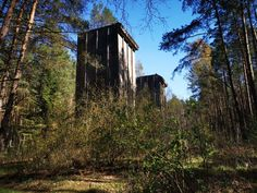 Hidden in a forest, forgotten in time, lies a fake 'city' - one of the last remains of Hitler's dream of the world capital 'Germania', Four buildings // towers, each 20 meters high, built of reinforced concrete that served as a test site for testing both bombs and construction, materials and types of buildings to build bomb-proof homes for civilians in Germania. #whitehouses #WorldWar2 #WW2 #german #Germania #Hitlers Places Around The World, Around The Worlds, Bunker Hill Los Angeles, Bunker Hill Monument, Doomsday Bunker, Derelict Buildings, Bomb Shelter, Copyright Images, Underground Bunker