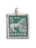 Vintage Sweden stamp designed in 1920. Features the heraldic lion supporting the arms of Sweden.