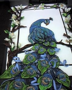 Lois Bandt Weber has won several NAQG awards in the past, hosted the convention last year in Florida where she lives,  and brought along quite a few of her framed pieces to display at this years event. She is devoted to quilling and with her outgoing personality and sense of humor, perfectly suited for teaching and generating interest in the art.