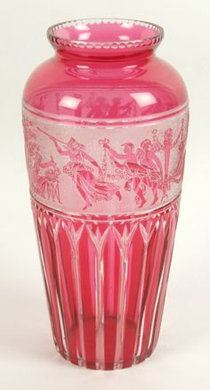 """MOSER STYLE ART DECO GLASS VASE. Moser style Art Deco glass vase, ruby flash with cut vertical lancet lower section, white relief band of classical procession, notched top rim, polished pontil. No mark. Size: 9 3/4""""H, 3 1/4"""" diameter top, 5"""" diameter widest part, 3 1/4"""" diameter base."""