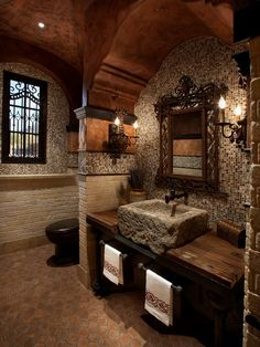 Mediterranean Master Bathroom with Solistone Terra Cotta Hexagon Tile, penny tile floors, Vessel sink, Wall sconce, Casement
