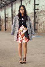 grey coat and bright skirt