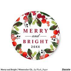 "Merry and Bright | Watercolor Christmas Wreath Classic Round Sticker Holiday sticker design features a beautiful Christmas foliage watercolor design with green leaves and red berries frames stylish ""Merry and Bright"" with custom year text."