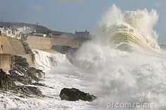 Atlantic storms off the south west coast of Cornwall often produce huge seas and Porthleven, as seen here, experiences some spectacular and destructive weather.