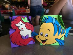Little mermaid and flounder mini boxes filled with gold fish cookies for Kianna's 6th birthday