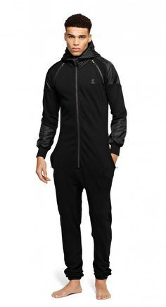Fitted jumpsuit made out of premium piqué cotton with polyamide contrast fabric on sleeves and hoodie. The jumpsuit has detachable sleeves to turn it into a short-sleeved jumpsuit. Fitted Jumpsuit, Jumpsuit With Sleeves, Black Jumpsuit, Style Masculin, Suit Accessories, Mens Fashion Suits, Fashion Edgy, Men In Uniform, Character Outfits