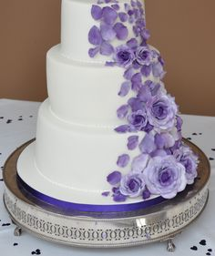 Cascading purple roses Wedding Cake by Sweet Bliss Bakes