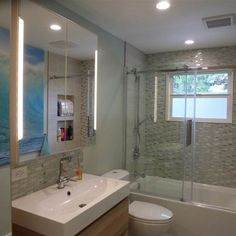 Clean Modern 5x10 bathroom. Glass mosaic tile, GODMORGON Cabinet, BRÅVIKEN Sink, DALSKAR Faucet, GODMORGON High Cabinet with Mirrored Door, and STORJORM Mirror cabinet w/2 doors & light