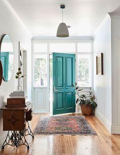 Bright entry way + coloured door