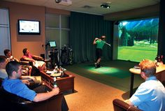 Golf School Tee Times Indoor Golf can coordinate games or lessons for corporate groups on the facility's six high-definition golf simulators. Golf Bar, Indoor Golf Simulator, Golf Room, Famous Golf Courses, Golf Instructors, Golf Simulators, Golf Practice, Golf Training, Golf Lessons
