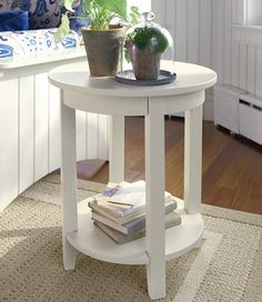 Rusty has a lovely roundly end table ready for you to paint and decorate like this cottage inspiration room!  Auction is September 18 - 22