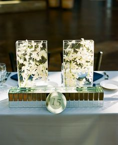 Formal Modern Classic  // Modern wedding tables with white orchids submerged in a clear vase