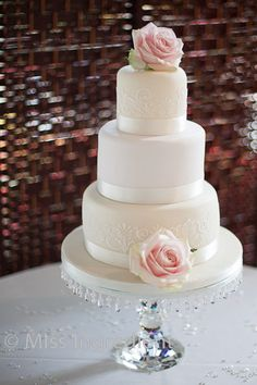 ivory tier wedding cake stencilled design with roses bournemouth