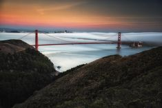 Photo @ladzinski / Lingering color of twilight lingering over #SanFrancisco and the iconic #GoldenGateBridge. The bridge is an internationally recognized symbol of the city and considered a modern wonder of the world. The orange color was chosen in an effort to be more visible in fog and to complement the bridges natural surroundings. This photo was taken from #hawkhill the perfect place to watch the fog roll in and listen to the barges blowing their horns. by natgeotravel