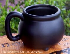 Witchcrafts Artisan Alchemy - BLACK CAULDRON Bewitching Witch's Mug, $34.95 (http://www.witchcraftsartisanalchemy.com/black-cauldron-bewitching-witchs-mug/)