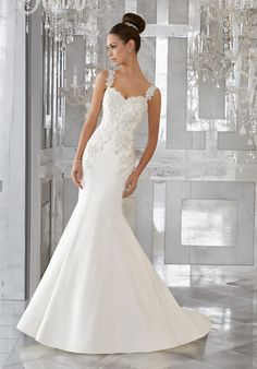 Mori Lee Style 5575 features Crystal Beaded, Embroidered Appliqués. Sz. 6, Ivory, $1,175 is available at Debra's Bridal Shop at the Avenues, 9365 Philips Hwy., Jacksonville, FL 32256. Contact us for your consultant appointment at 904-519-9900.