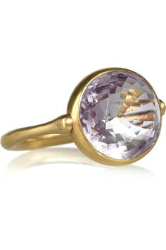 Marie-Helene de Taillac amethyst and gold swivel ring from Net-a-Porter.com. Absolutely in love with this ring.