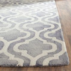The Dip Dye Double Trellis Rugs from Safavieh feature a traditional motif updated with a fashion-forward, dip-dyed coloration to inject warmth and a striking accent to any contemporary decor. Dense, soft pile is hand-tufted and made from premium wool. Watercolor Rug, Trellis Rug, Washable Rugs, Quatrefoil, Accent Rugs, Blue Ivory, Grey Rugs, Muted Colors, Contemporary Decor
