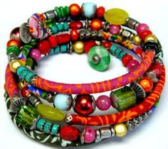 Bracelets - Wrap fibers around coiled bracelet (to thinken insert  tubing or tape before wrapping) & add beeds