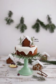 Adorable gingerbread cake topped with royal icing snow, a snowy homemade DIY gingerbread house and a rosemary mini Christmas pine tree forest. So adorable, festive, and a delicious holiday dessert. Also a fun Christmas gift DIY to make with kids! Holiday Cakes, Christmas Desserts, Christmas Baking, Christmas Cookies, Christmas Holidays, Xmas, Holiday Treats, Christmas Recipes, Homemade Christmas Gifts