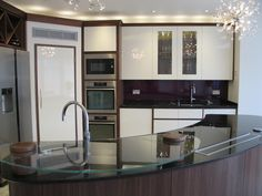 You can see the pop up extractor in the top of the island unit.  Very sleek and so efficient and out of the way when not in use. For more kitchens with clever appliances, please take a look at our website.