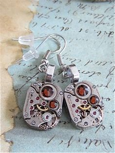 One-of-a-Kind Handcrafted Jewelry Created with Recycled Vintage Watch Parts and Found Objects These earrings are created using real vintage jeweled...