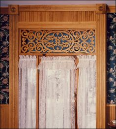 Queen Victorian Fretwork Panel in parlor entry. over door and side lights;  this is an actual home not dollhouse, but it is great inspiration