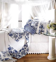An elegant mix ofblue and white French Linens  making for a very inviting room in taste and style. JH