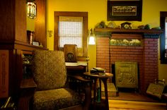 Living Room. Light fixture: Meyda Tiffany, Parker Poppy Morris chair- late 1800s Fireplace tile: Ravenstone Tile Print: Kathleen West Art pottery: Ephraim, Weller, Hog Hill, Zanesville