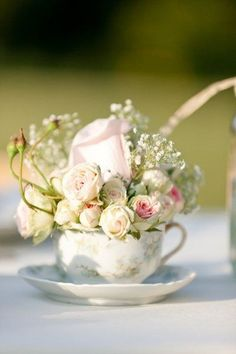 cupful of blooms centerpieces - great for an antique, English garden style wedding. simple and sweet.
